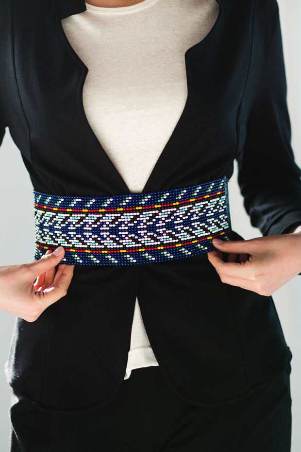 beaded belt with leather ties in blue arrow pattern worn with jacket