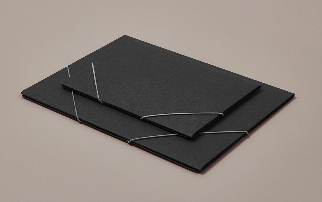 "Charcoal black ""chemise"" portfolio folder with grey elastic"