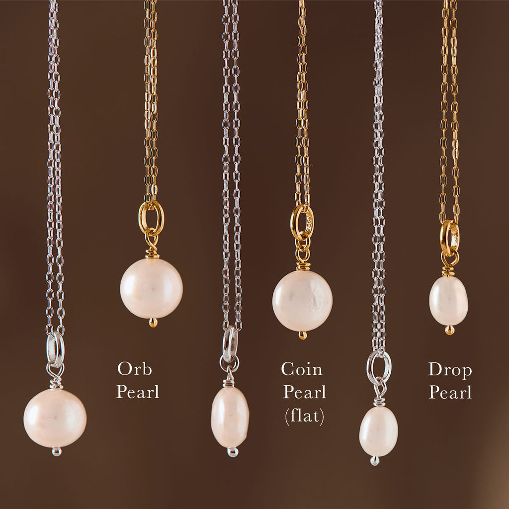 6 hanging necklaces in silver and gold each with pearl charms adorned