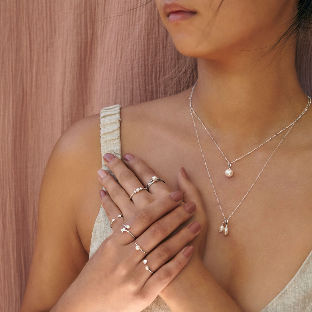 Pearl rings and necklaces featured on model