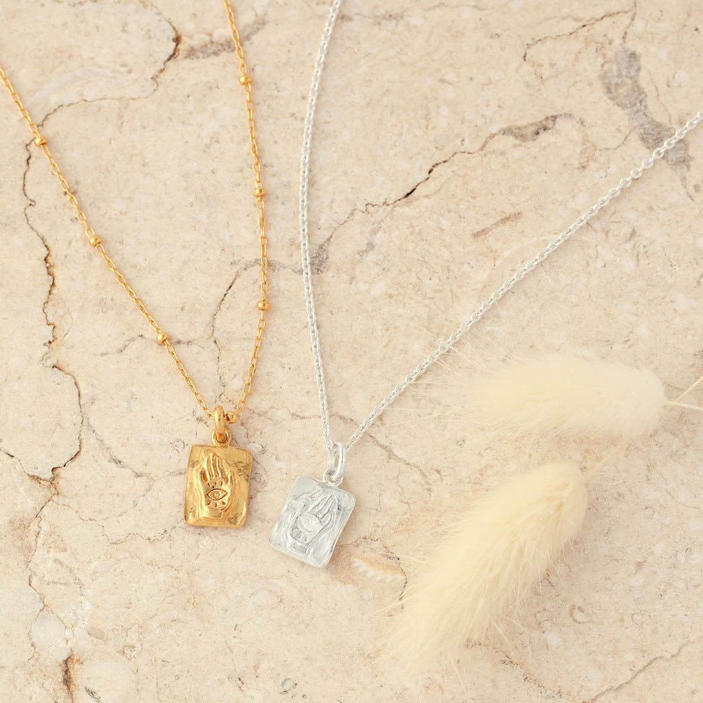 balance neck charms from the midsummer x thane collection