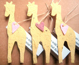 plantable paper giraffes with pink hearts