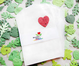 Recycled Ideas Favors glassine favor bags with plantable paper leaves