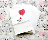 Recycled Ideas Favors glassine favor bags with plantable paper confetti elephants