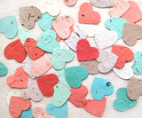 Recycled Ideas Favors plantable paper flower seed hearts in rainbow colors