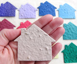 plantable seed paper house in hand - beige real estate promotion