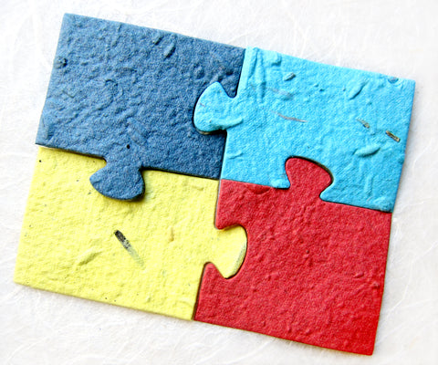 Recycled Ideas Favors plantable paper puzzle pieces