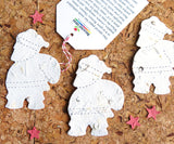 Recycled Ideas Favors plantable paper Santas with gift tag
