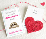 Recycled Ideas Favors plantable paper heart with sloth-themed cards