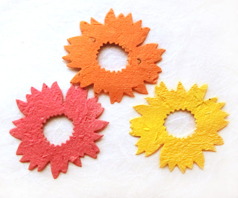 Recycled Ideas Favors plantable paper sunflowers in red, orange and gold