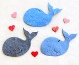 Recycled Ideas Favors plantable paper blue whales with mini hearts