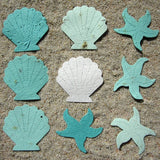 Recycled Ideas Favors aqua and white plantable paper shells and starfish