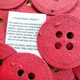 Recycled Ideas Favors plantable paper buttons in red