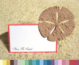 Recycled Ideas Favors tan plantable paper sand dollar with seating card