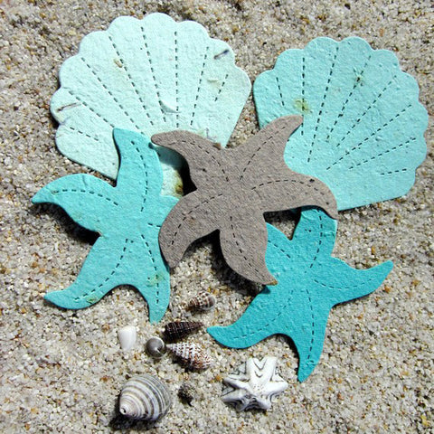 Recycled Ideas Favors aqua and gray plantable paper shells and starfish