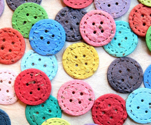Recycled Ideas Favors plantable paper buttons in rainbow colors