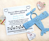 Recycled Ideas Favors plantable paper blue airplane with card and map hearts
