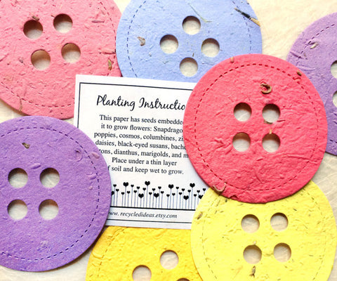 Recycled Ideas Favors plantable paper buttons in rainbow colors with card