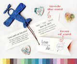 Recycled Ideas Favors plantable paper blue airplane with cards and map hearts
