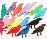 Recycled Ideas Favors plantable paper crows in rainbow colors