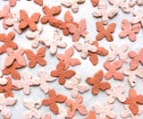 Recycled Ideas Favors pink and white confettie butterflies