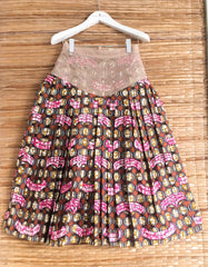 PLEATED WAX PRINT SKIRT WITH MESH AND EMBROIDERY DETAIL