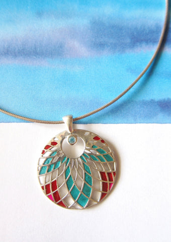 Exquisite, jali cut-out pattern round enamel pendant