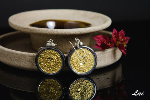 Elegant, Thappa (stamped) round gold-plated earrings with oxidized silver frame  Earrings Sterling silver handcrafted jewellery. 925 pure silver jewellery. Earrings, nose pins, rings, necklaces, cufflinks, pendants, jhumkas, gold plated, bidri, gemstone jewellery. Handmade in India, fair trade, artisan jewellery.