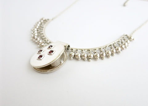Vintage inspired, gorgeous locket necklace in sterling silver and garnet (PB-1974-N)  Necklace, Pendant Sterling silver handcrafted jewellery. 925 pure silver jewellery. Earrings, nose pins, rings, necklaces, cufflinks, pendants, jhumkas, gold plated, bidri, gemstone jewellery. Handmade in India, fair trade, artisan jewellery.
