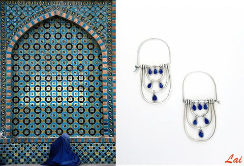 Glamorously chic, elongated hoops with faceted lapis drops