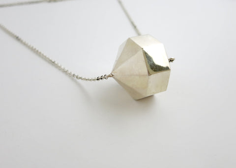 Exquisite, minimalist, 24-sided polygon locket necklace in sterling silver (PB-9349-N)  Necklace, Pendant Sterling silver handcrafted jewellery. 925 pure silver jewellery. Earrings, nose pins, rings, necklaces, cufflinks, pendants, jhumkas, gold plated, bidri, gemstone jewellery. Handmade in India, fair trade, artisan jewellery.