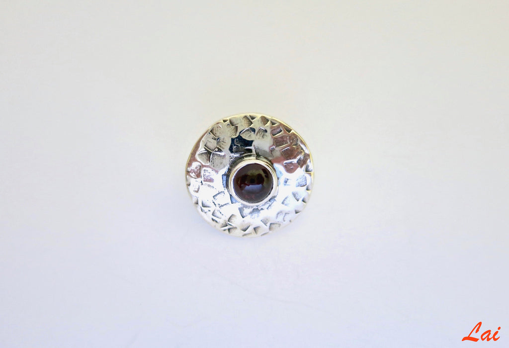 Big round textured nose pin with garnet (PB-023-NP)  Nose pin Sterling silver handcrafted jewellery. 925 pure silver jewellery. Earrings, nose pins, rings, necklaces, cufflinks, pendants, jhumkas, gold plated, bidri, gemstone jewellery. Handmade in India, fair trade, artisan jewellery.