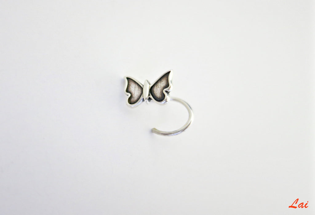 Dainty, and very quaint butterfly nose pin  Nose pin Sterling silver handcrafted jewellery. 925 pure silver jewellery. Earrings, nose pins, rings, necklaces, cufflinks, pendants, jhumkas, gold plated, bidri, gemstone jewellery. Handmade in India, fair trade, artisan jewellery.