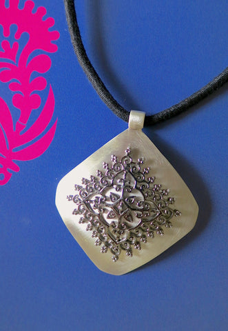 Gorgeous, kite-shaped pendant with mehndi-inspired black rhodium plated center unit