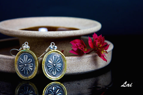 Graceful, oval Thappa (stamped) earrings with contrasting gold plated frame  Earrings Sterling silver handcrafted jewellery. 925 pure silver jewellery. Earrings, nose pins, rings, necklaces, cufflinks, pendants, jhumkas, gold plated, bidri, gemstone jewellery. Handmade in India, fair trade, artisan jewellery.