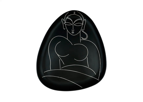 Decorative plate accent decor. Bidri metal and silver teardrop-shaped plate. Woman's outline in Kalighat painting style. Design led, luxe, handmade home decor art objects. Handmade in India by Lai and Craft Stories