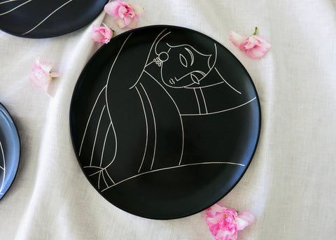 Decorative plate accent decor. Bidri metal and silver round plate. Woman with an earring. Design led, luxe, handmade home decor art objects. Handmade in India by Lai and Craft Stories