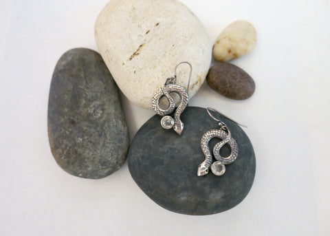 Whimsical, coiled snake earrings with faceted rock crystal