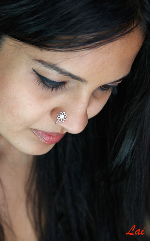 Minimalist, and elegant floral outline nose pin  Nose pin Sterling silver handcrafted jewellery. 925 pure silver jewellery. Earrings, nose pins, rings, necklaces, cufflinks, pendants, jhumkas, gold plated, bidri, gemstone jewellery. Handmade in India, fair trade, artisan jewellery.