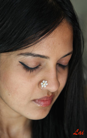 Elegant, dual-tone floral nose pin  Nose pin Sterling silver handcrafted jewellery. 925 pure silver jewellery. Earrings, nose pins, rings, necklaces, cufflinks, pendants, jhumkas, gold plated, bidri, gemstone jewellery. Handmade in India, fair trade, artisan jewellery.