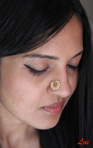 Regal, gold-plated, seed pearls studded, crescent nose pin  Nose pin Sterling silver handcrafted jewellery. 925 pure silver jewellery. Earrings, nose pins, rings, necklaces, cufflinks, pendants, jhumkas, gold plated, bidri, gemstone jewellery. Handmade in India, fair trade, artisan jewellery.