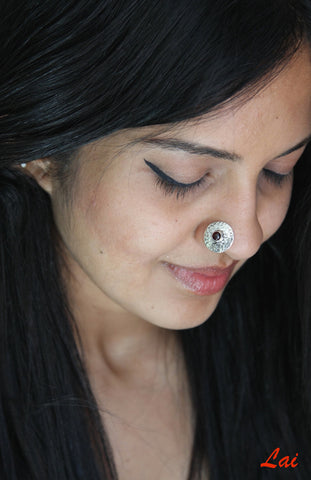 Big, round, textured nose pin with garnet center  Nose pin Sterling silver handcrafted jewellery. 925 pure silver jewellery. Earrings, nose pins, rings, necklaces, cufflinks, pendants, jhumkas, gold plated, bidri, gemstone jewellery. Handmade in India, fair trade, artisan jewellery.