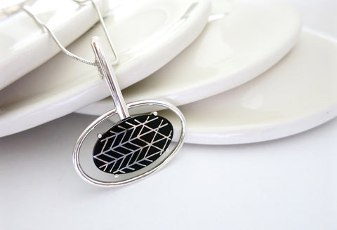 Contemporary, sophisticated oval Bidri pendant  Necklace, Pendant Sterling silver handcrafted jewellery. 925 pure silver jewellery. Earrings, nose pins, rings, necklaces, cufflinks, pendants, jhumkas, gold plated, bidri, gemstone jewellery. Handmade in India, fair trade, artisan jewellery.