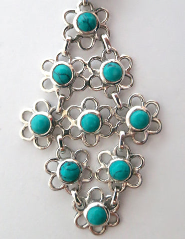 Chic Samarkand flexible linked floral units turquoise pendant (PBS-3744-P)  Necklace, Pendant Sterling silver handcrafted jewellery. 925 pure silver jewellery. Earrings, nose pins, rings, necklaces, cufflinks, pendants, jhumkas, gold plated, bidri, gemstone jewellery. Handmade in India, fair trade, artisan jewellery.