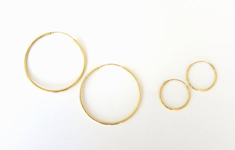 Big and small gold plated hoops  Earrings Sterling silver handcrafted jewellery. 925 pure silver jewellery. Earrings, nose pins, rings, necklaces, cufflinks, pendants, jhumkas, gold plated, bidri, gemstone jewellery. Handmade in India, fair trade, artisan jewellery.