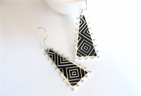 Chic, triangular, op-art earrings with fine hand painted black enamel work