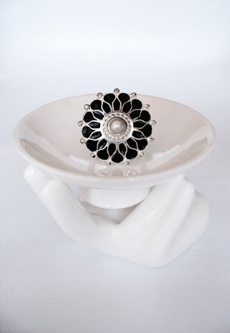 Ethereal, floral statement ring with a pearl centre and fine black enamel work