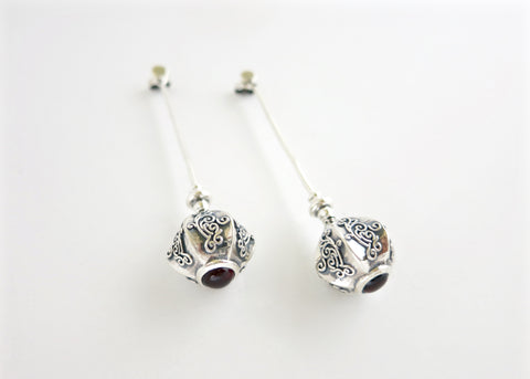 Arresting, graceful, long earrings with garnet (PB-10454-ER)  Earrings Sterling silver handcrafted jewellery. 925 pure silver jewellery. Earrings, nose pins, rings, necklaces, cufflinks, pendants, jhumkas, gold plated, bidri, gemstone jewellery. Handmade in India, fair trade, artisan jewellery.