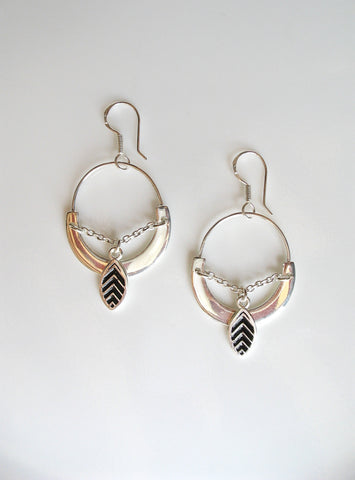 Unique oval earrings with black enamel leaf charm dangling from chain (PB-4947-ER)
