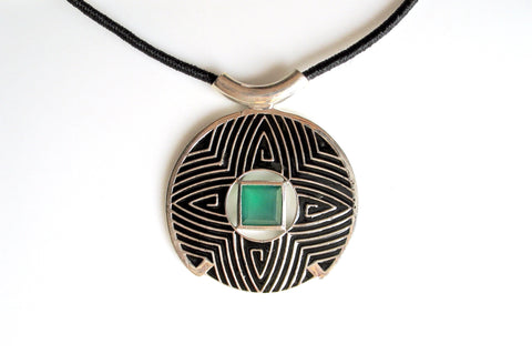 Gorgeous, large round pendant with fine black enamel work and a faceted chrysoprase